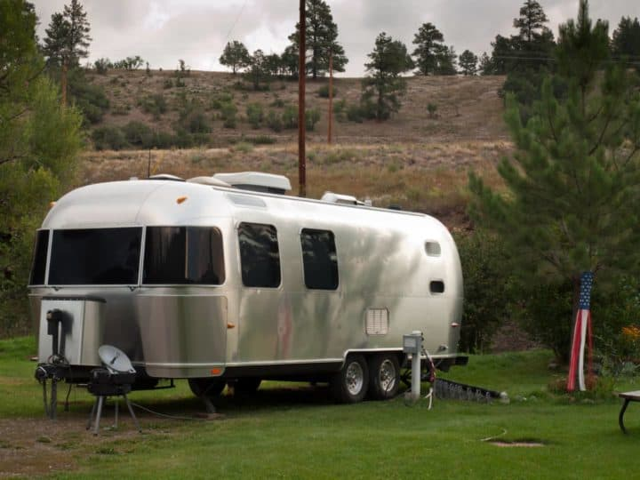 Airstream travel trailer parked at campground campsite