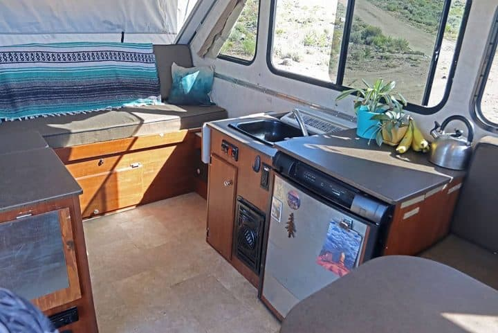 Aliner small RV trailer kitchen and seating