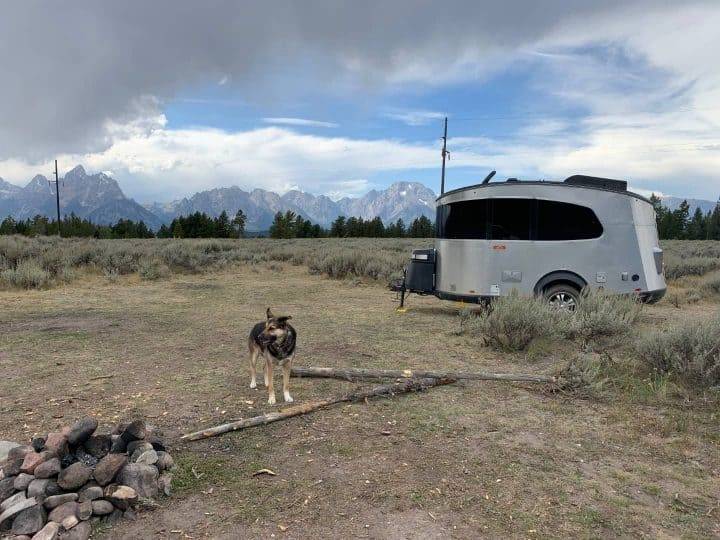 Basecamp small camper trailer at camp