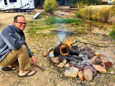 Camp Addict Co-Founder Marshall with fire