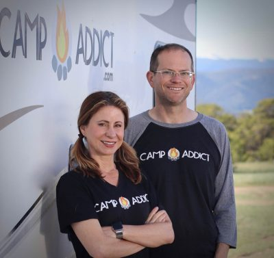 Camp Addict co-founders Kelly and Marshall against trailer