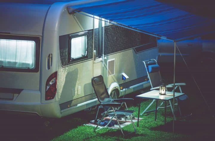 Camp table under travel trailer awning