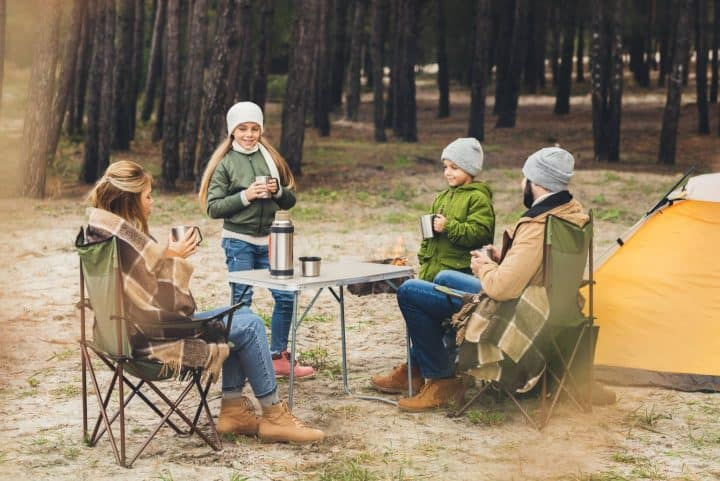 Family around camp table