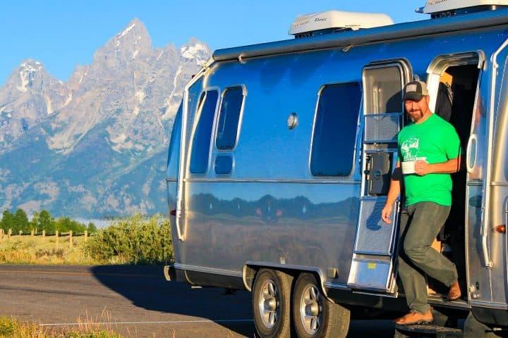 Greg walking out of Airstream at Tetons