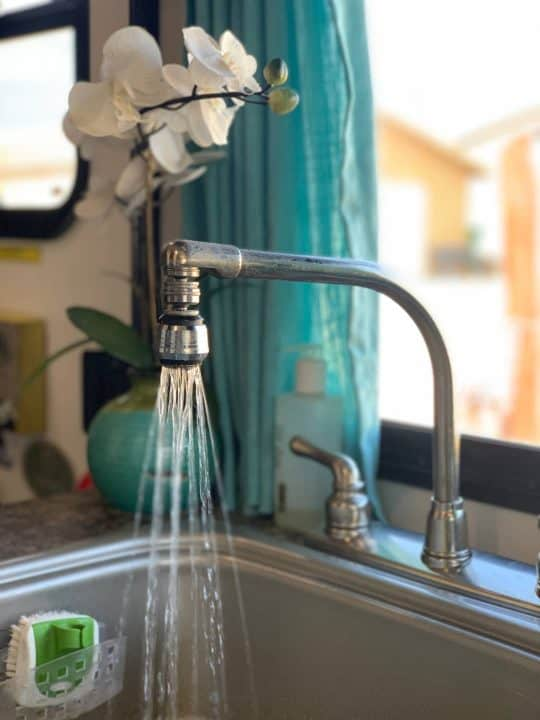 Kelly's kitchen faucet running