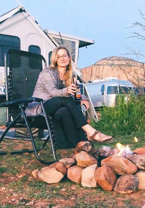 Keri in front of Aliner small RV trailer