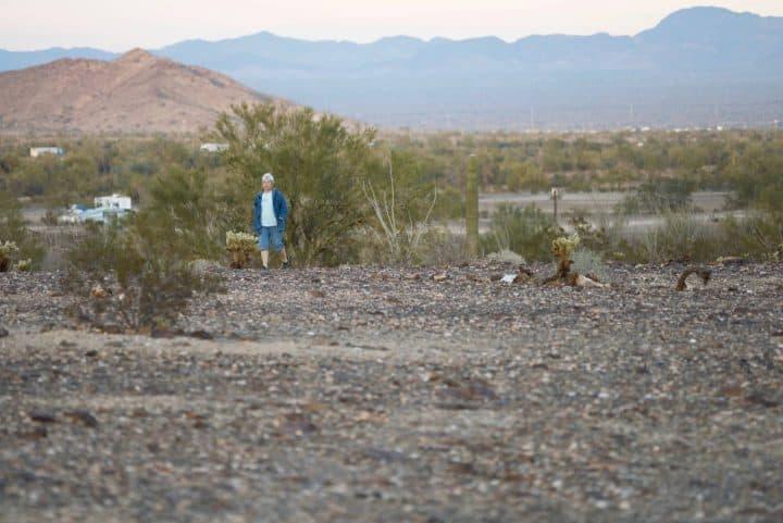 Lady standing in desert