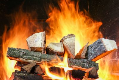 Lincoln log style fire burning