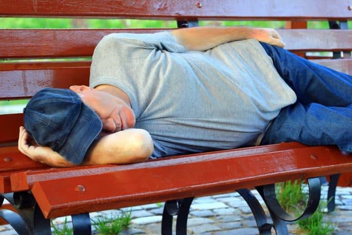 Man sleeping on bench