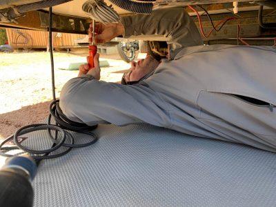 Marshall installing wiring under rig