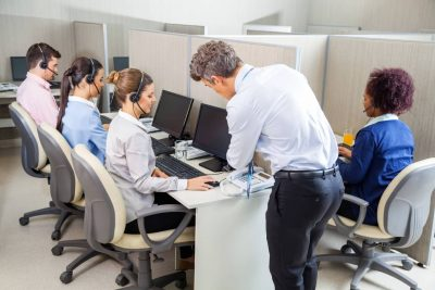 Office workers sitting at cubicle