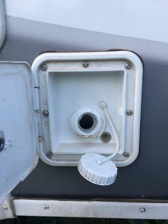 RV water fill door open