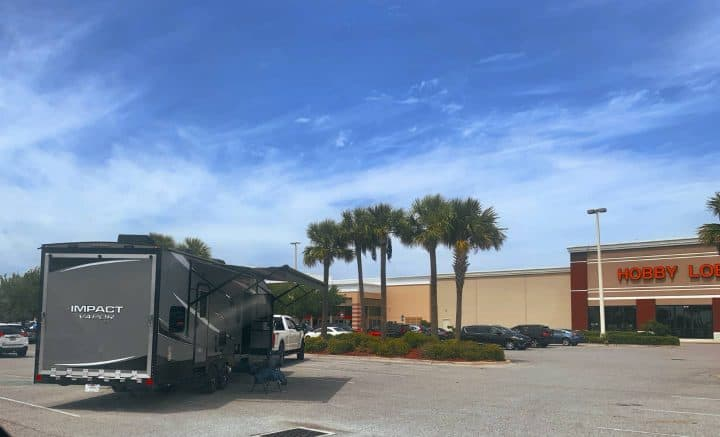 RV with canopy out in parking lot