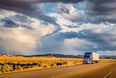 Semi driving thru desert
