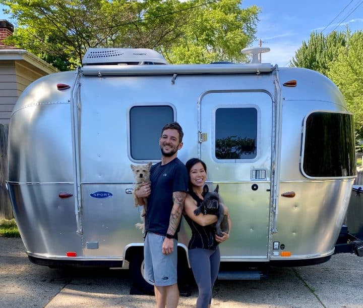 Shawna and Ray in front of Airstream Bambi small camper