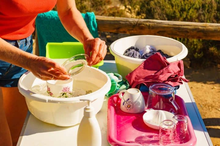 Washing dishes at campsite